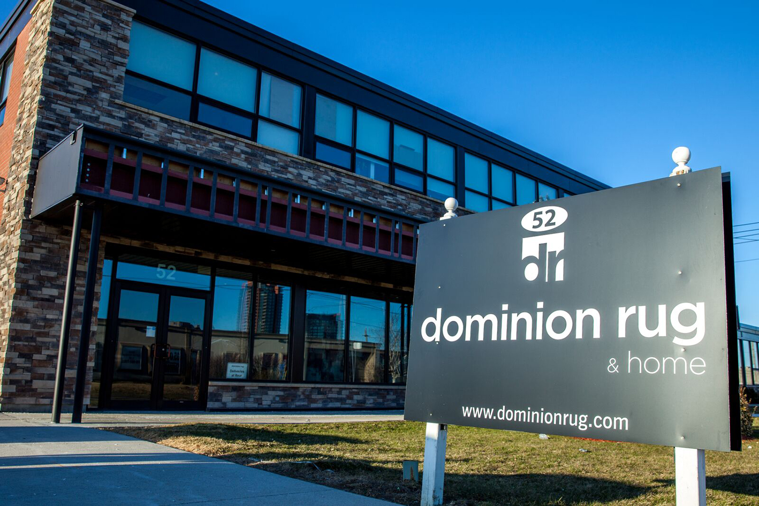 Dominion Rugs sign